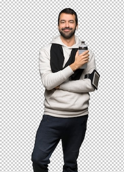 Sport man holding a hot cup of coffee