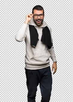 Sport man with glasses and surprised