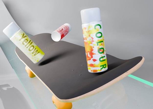 Spray cans on top of skateboard
