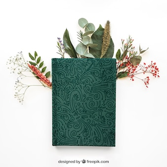 Spring concept mockup with book on leaves