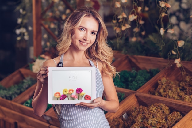 Spring concept with woman holding tablet mockup