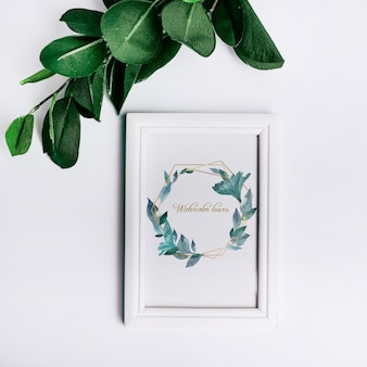 Spring frame mockup with decorative leaves in top view