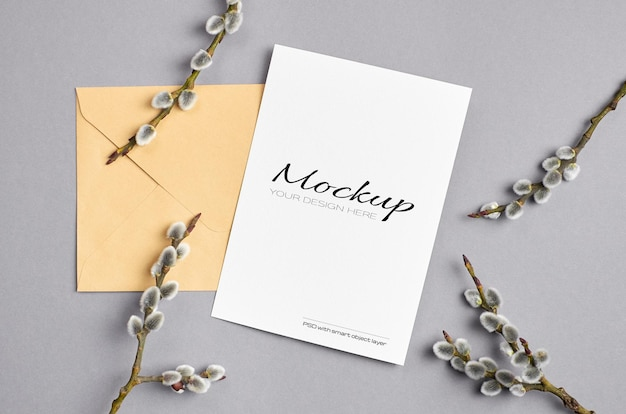 Spring greeting card mockup with envelope and pussy willow twigs