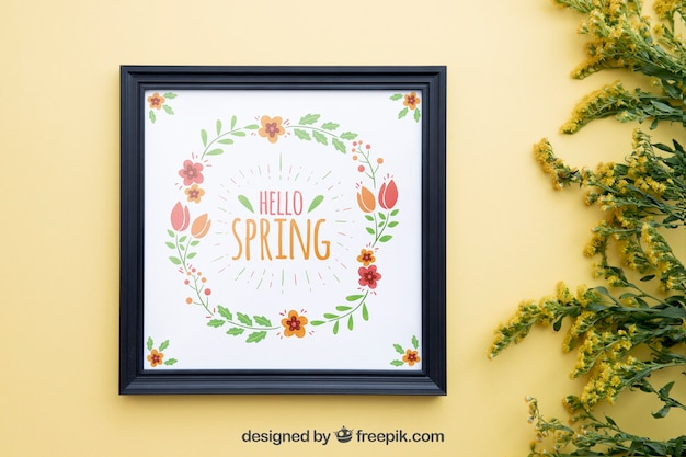 Spring mock up with frame and wildflowers on right