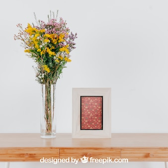 Spring mockup with vertical frame and vase of flowers