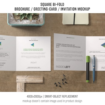 Square bi-fold brochure or greeting card mockup in top view