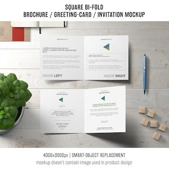 Square bi-fold brochure or greeting card mockup with basil plant
