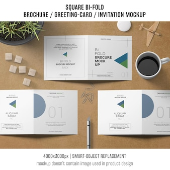 Square bi-fold brochure or greeting card mockup with still life concept