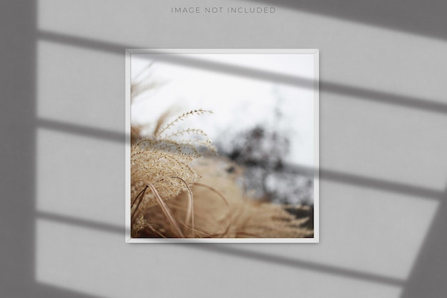 Square blank picture frame mockup with shadow overlay