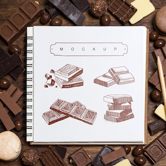 Square booklet mockup on chocolate background