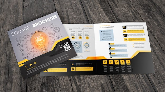 Square brochure mockup on wooden surface