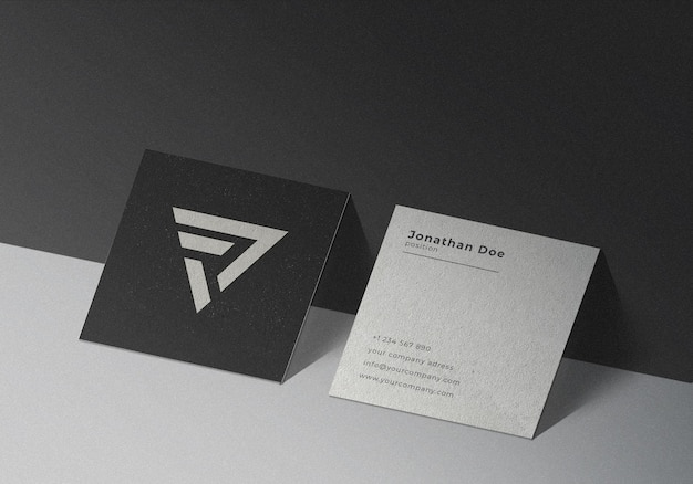 Square business card mockup on black textured background