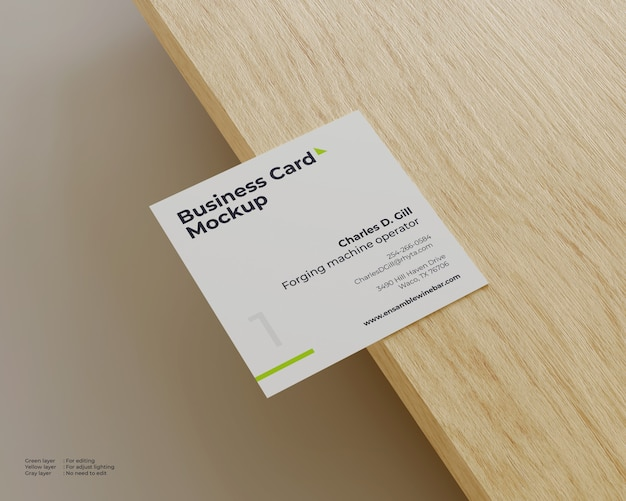 Square business card mockup on the top end of the wood