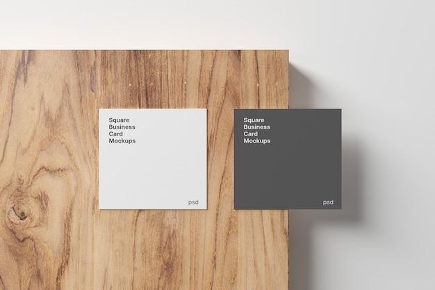 Square business card mockup on wood panel