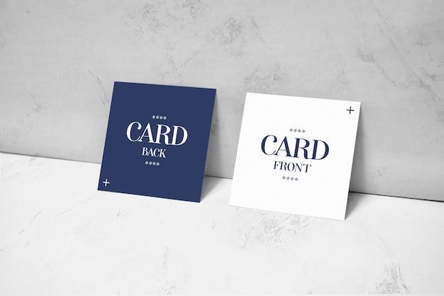 Квадратные карты лежали на стене макет Premium Psd