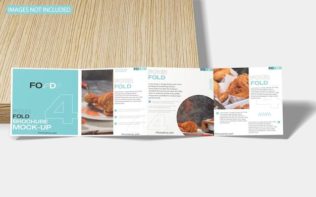 Квадратный четырехслойный макет брошюры на мраморе