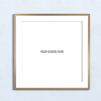 Square golden frame mockup on white textured wall