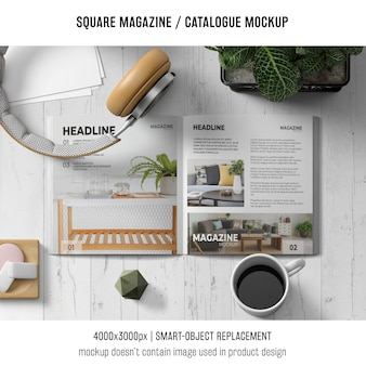 Square magazine or catalogue mockup with headphones and coffee