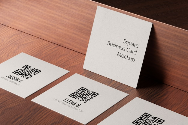 Square paper business cards mockup on wooden table