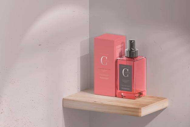 ボックスモックアップ付きの正方形の香水瓶 無料 Psd