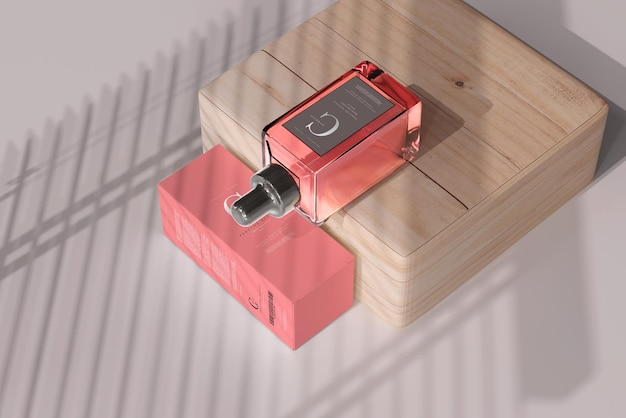 ボックスモックアップ付きの正方形の香水瓶