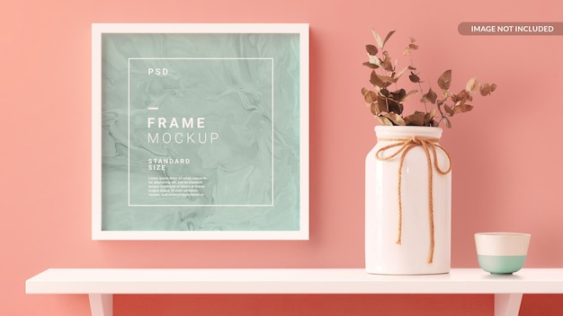 Square photo frame mockup hanged in the home wall with a shelf in 3d rendering