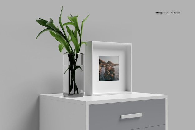 Square picture frame mockup on small cupboard