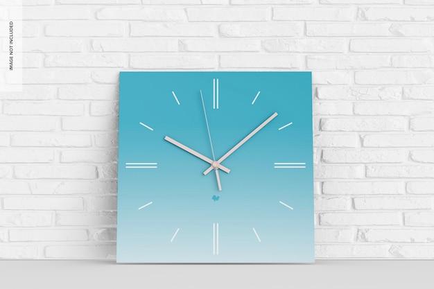 四角い壁時計のモックアップ、傾いた