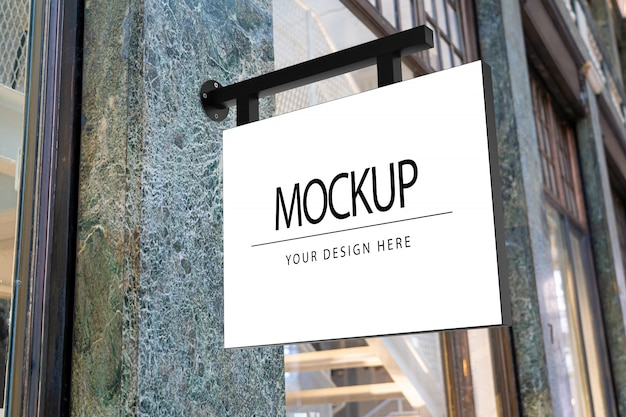 Square white company sign mockup for shop logo in the street