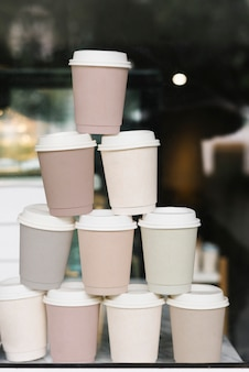 Stacked paper coffee cups mockup