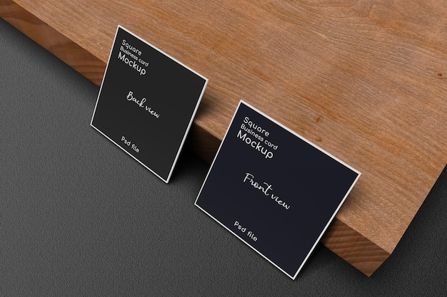 Standing square business card mockup on wood plank