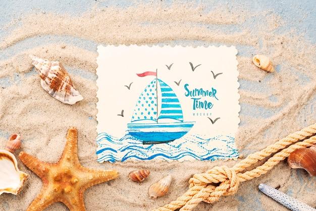 Морская звезда с цитатой на лето в песке