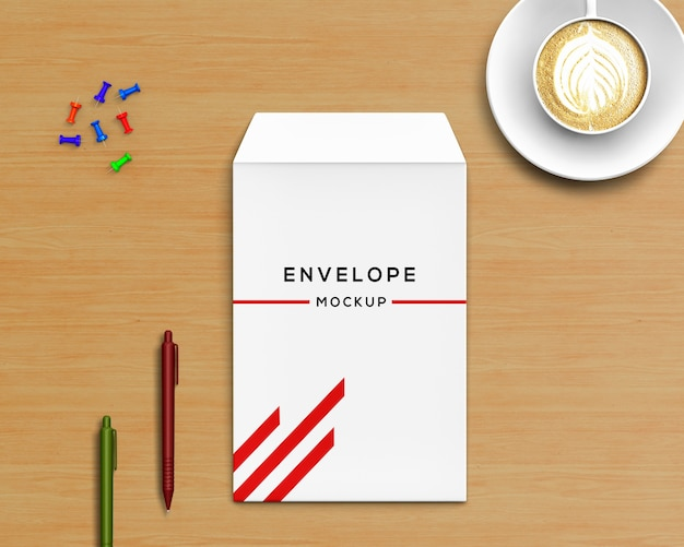 Концепция канцелярских принадлежностей с макетом конвертов и кофе