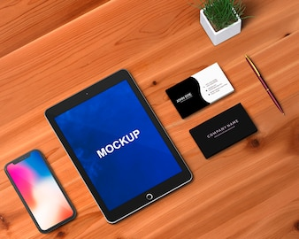 Stationery concept with tablet and smartphone mockup