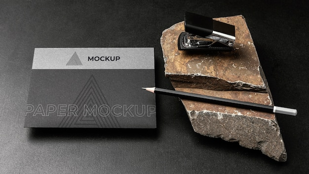 Stationery mock-up on dark concrete with rugged rock