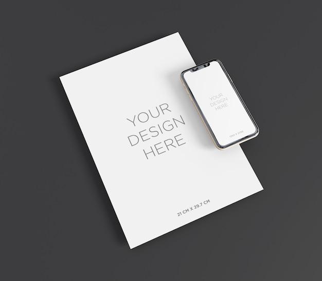 Макет канцелярских товаров с бумагой формата а4 и перспективой смартфона