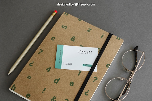 Stationery mockup with business card on book