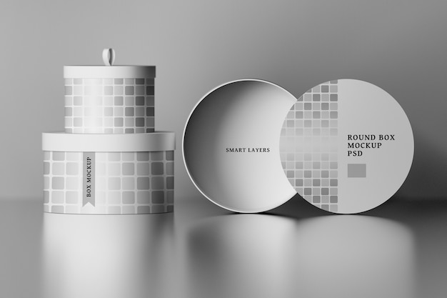 Stationery mockup with round packaging boxes with editable labels over shiny surface