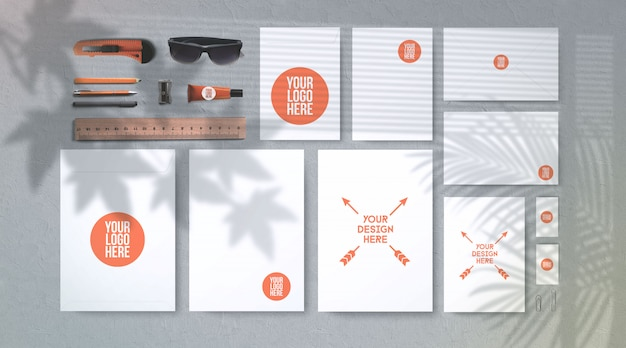 Stationery and school supplies mockup isolated on gray with plant shadows