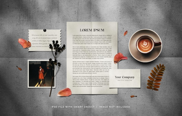 Stationery set mockup with a cup of coffee and dried plants