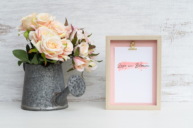 Still life frame and at watering can with bouquet of roses mockup