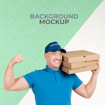 Strong delivery man holding a bunch of pizza boxes