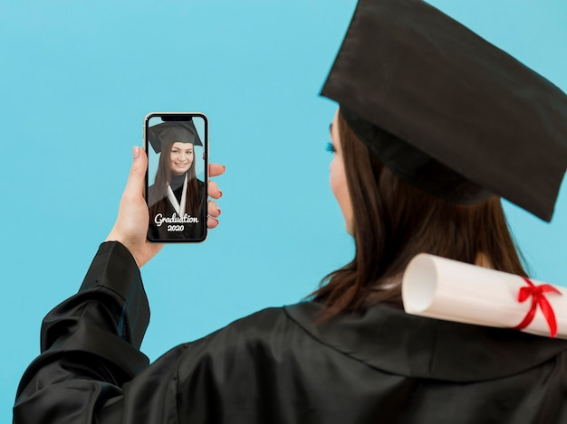 Student celebrating graduation with video call