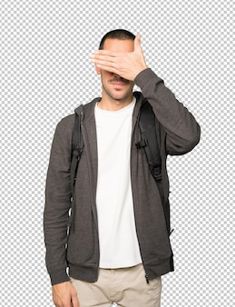 Student covering his eyes with his hands
