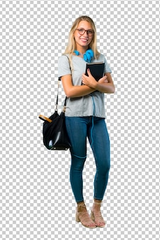 Student girl with glasses keeping the arms crossed in lateral position while smiling. confident expression
