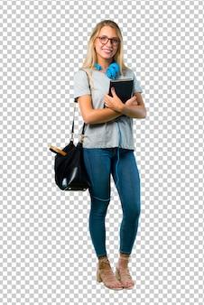 팔을 유지하는 안경 학생 소녀 웃 고있는 동안 측면 위치에 넘어. 자신감 표현