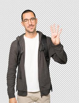 Студент, делая жест номер четыре