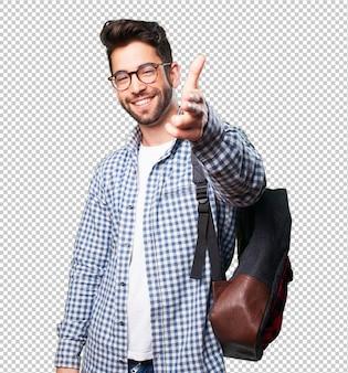 Student man doing gun gesture