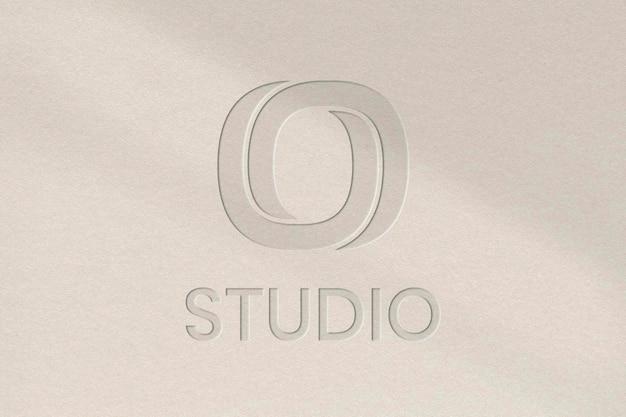 Studio business logo psd template in debossed paper texture