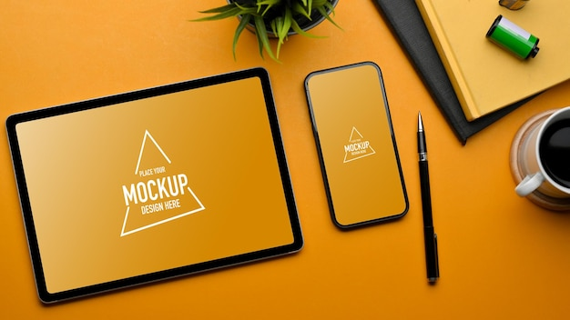 Stylish flat lay workspace with tablet and smartphone mockup